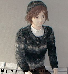 Doll in gray knit