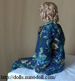 Doll in flowery suit
