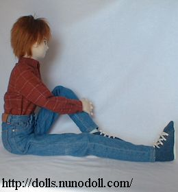 Doll in jeans