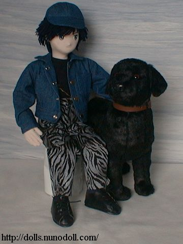 Boy and black Labrador