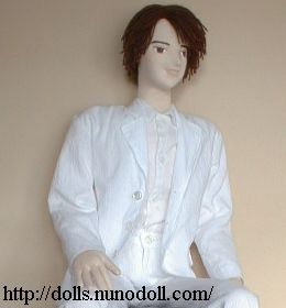 Doll in white suit